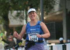 Angela smiling as she approaches the finish line! (courtesy of Brightroom Photography)